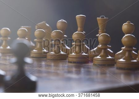 Chess On A Chessboard, Black Pawn Against An Army Of White