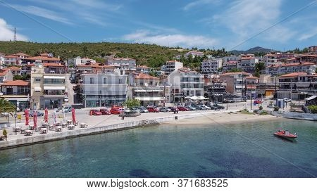 Chalkidiki, Greece - June 11 2020: Greek Coastal Village Landscape Drone Shot. Aerial Day View Of Ne