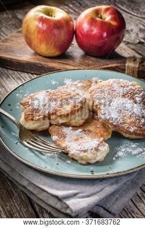 Sweet Pancakes Made Of Apple, Milk And Flour.