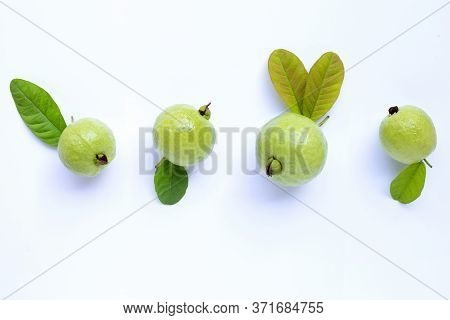 Top View Of Fresh Ripe Guava And Slices With Leaves.