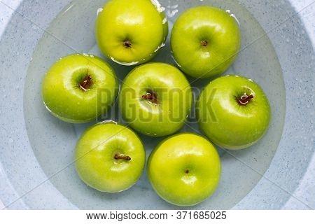 Soak Green Apples In Water. Washing Fruit Concept