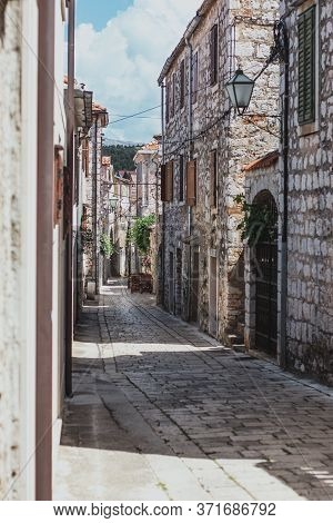 Narrow Old Streets In The Town Of Starigrad On The Island Hvar. Old Greek Style Stone Houses And A N