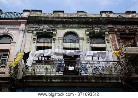 Havana, Cuba - September 24, 2017: Clothes Hanging In The Sun On A Balcony Of A Historic And Decaden