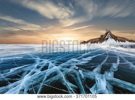 A Picturesque Frozen Lake On The Background Of A Snow Glacier.