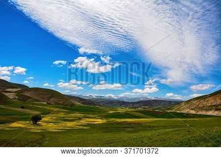 Beautiful Green Mountain Slopes On The Background Of The Fairy-tale Sky.
