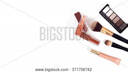 Makeup Brush And Decorative Cosmetics On A White Background