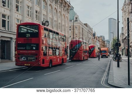 London, Uk - June 13, 2020: Row Of Modern Red Double Decker Buses On Tottenham Court Road, London. I