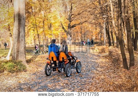 Couple People Enjoy Riding Pedal Surrey Cart Bike Rent Or Sharing Outdoors In Beautiful Golden Autum