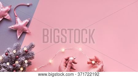 Hands Decorating Small Artificial Xmas Tree With Light Garland And Magenta Trinkets, Copy-space. Chr