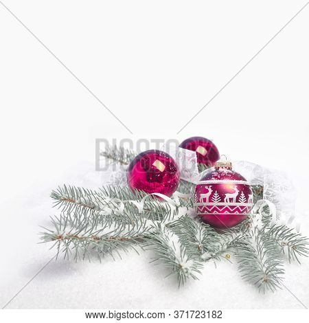 Shiny Sparkling Golden Christmas Baubles And Trinkets On Abstract Winter Blue White Background With