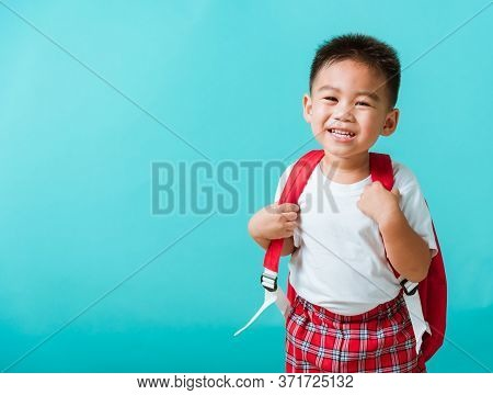 Back To School Concept. Portrait Closeup Happy Asian Cute Little Child Boy In Uniform Smiling, Isola