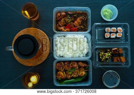 Asian Food, Sushi, Rolls, Rice And Chicken Skewers. Food In Disposable Dishes. Order Asian Food At H