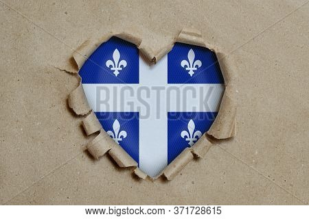 3d Illustration. Heart Shaped Hole Torn Through Paper, Showing Quebec Flag