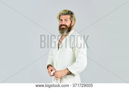 Spa Resort. Hotel Apartments. Bearded Guy Wearing White Bathrobe. Take Steps To Improve Your Sleep H
