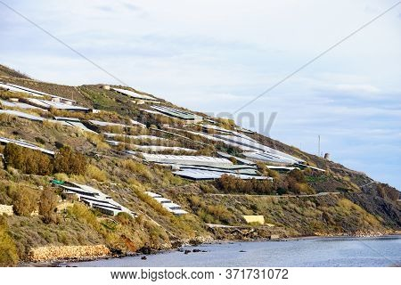 Spanish Landscape And View Of Sea Coast With Many Plastic Greenhouses On Hills. Almeria Region, Anda