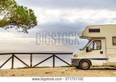 Motor Home On Spanish Coast, Seaside Cliffs Of Maro Cerro Gordo. Costa Del Sol, Andalusia Spain. Vis