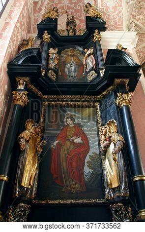 ZAGREB, CROATIA - MAY 16, 2013: Altar of Saint Apollonia in the Church of Saint Catherine of Alexandria in Zagreb, Croatia