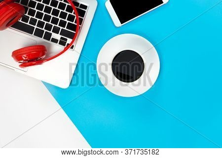A Red Headphones, Top View Of Red Headphones With Laptop Keyboard On Blue And White Background. Mini