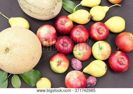 Fresh Organic Seasonal Fruits On Black Table, Healthy Food In Vegetarian Diet