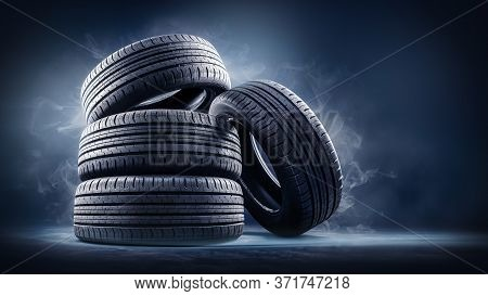 Close Up Of Four Tires Against Black