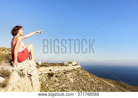 Female Tourist Enjoy Mesa Roldan Lighthouse View, Cabo De Gata Nijar Natural Park In Almeria Provinc