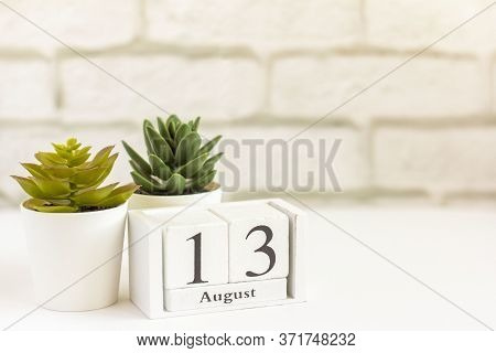 August 13 On A Wooden Calendar Next To The Alarm Clock. Summer Day, Empty Space For Text.calendar Fo