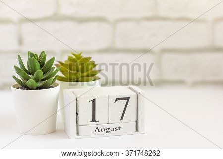 August 17 On A Wooden Calendar Next To The Alarm Clock. Summer Day, Empty Space For Text.calendar Fo