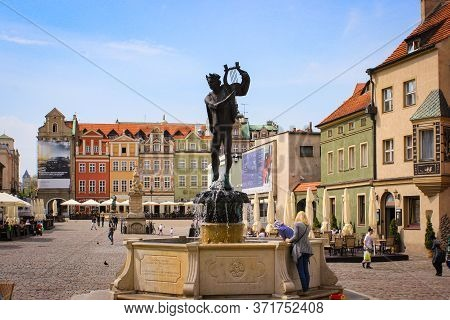 Poznan, Poland - May 05, 2015: People Walk In The Central Square Of The Old Town Near The Town Hall.