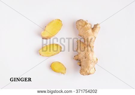 Ginger Roots And Ginger Sliced On White Background. Ginger Used As Spice For Food And Treatment In A