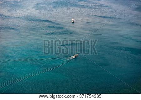 Pleasure Boats At Sea On A Sunny Day. Summer Holiday Season.