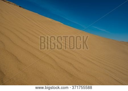 Blue Sky And Sand Surface In The Dunes. Sunny Day.