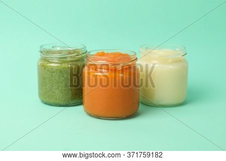 Glass Jars With Vegetable Puree On Mint Background. Baby Food