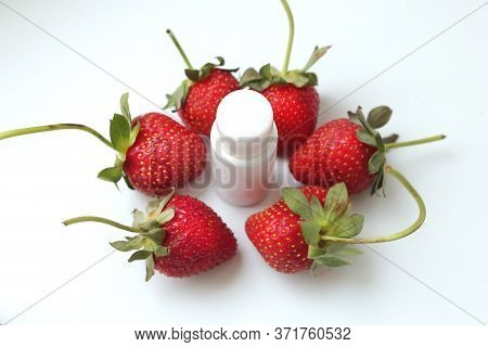 White Free Cosmetic Tube Surrounded By Strawberry Berries On A White Background. Strawberry Gel With