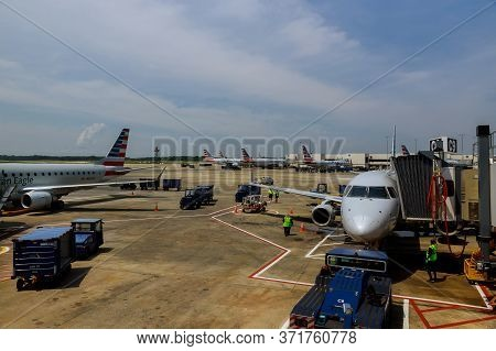 10 Jun 20 Charlotte, Nc Us: Front View Of Landed Airplane In A Terminal Of Airplane From American Ai