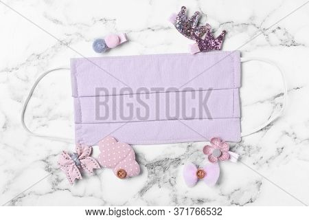 Homemade Protective Mask And Adorable Girly Hair Clips On White Marble Background, Flat Lay. Sewing