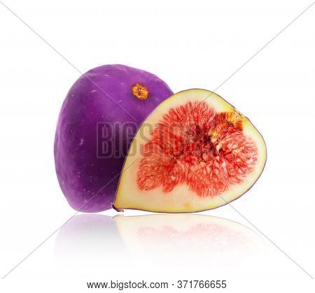 Whole And Sliced Ripe Purple Fig Closeup On A White Background