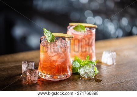 Sea Breeze Cocktail With Ice And Fresh Mint, On A Dark Background.