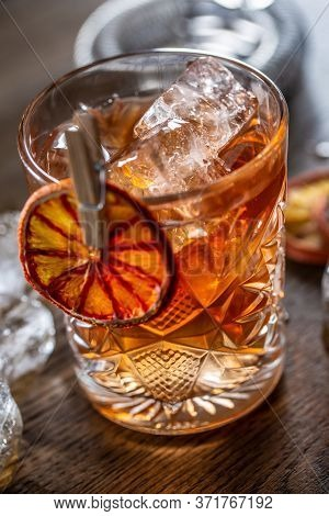 Smoked Old Fashioned Cocktail With Ice In An Ornamental Glass.