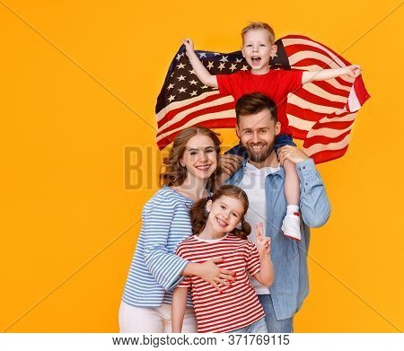 Happy American Family With The Usa Flag Celebrates Independence Day On July 4