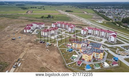 New Residential Area In Small Town. Aerial View. Condominium Concept.