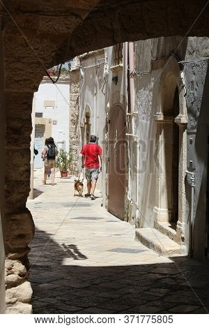 Polignano A Mare, Italy - May 29, 2017: People Visit Polignano A Mare Old Town In Apulia, Italy. Wit