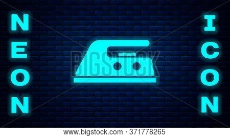 Glowing Neon Electric Iron Icon Isolated On Brick Wall Background. Steam Iron. Vector Illustration