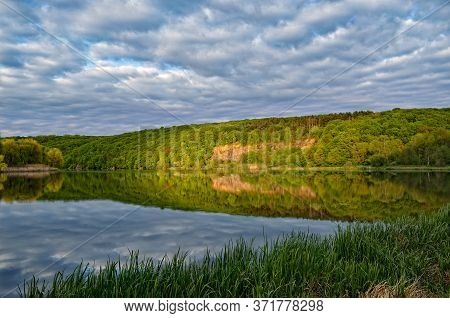 Landscape Of A Forest Lake On A Background Of Cloudy Sky.