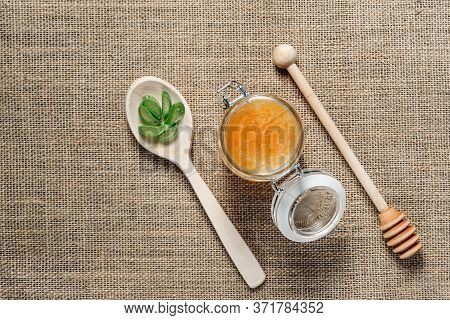 Jar Of Honey, A Wooden Spoon For Honey And A Spoon With Chopped Aloe Vera Leaves On Burlap. Alternat