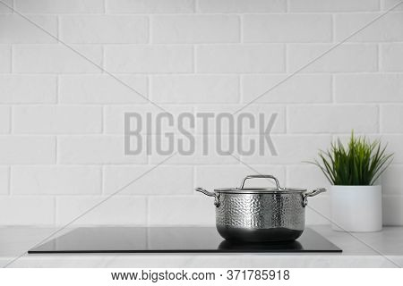 Saucepot On Induction Stove In Kitchen, Space For Text