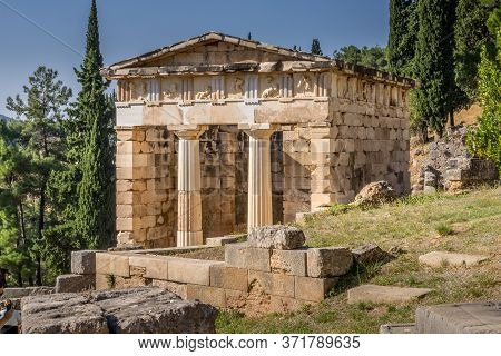 Reconstructed Athenian Treasury With Doric Columns And Stone Block Construction At Delphi In Greece.