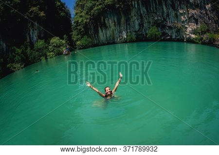 Happy And Positive Girl Having Fun In The Water And Rise Up Her Hands. Summer Tourism, Vacation, Hol