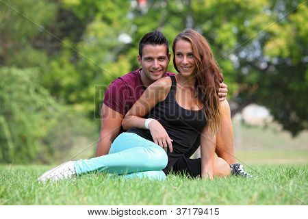 Loving couple sitting in a park