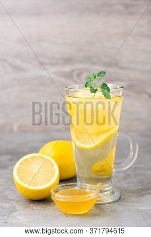 Therapeutic Drink Of Lemon, Honey And Mint In A Glass On The Table. Alternative Medicine, Treatment