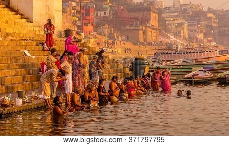 Varanasi, India - Mar 8, 2017. People Bathing And Offering Prayers To The Sacred River Ganges.